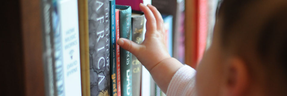 Child Reaching For a Book